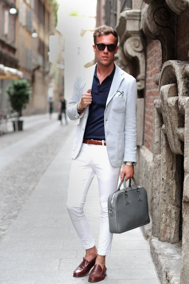 Dark blue shirt, white pants, leather belt and shoes, and leather bag  complete
