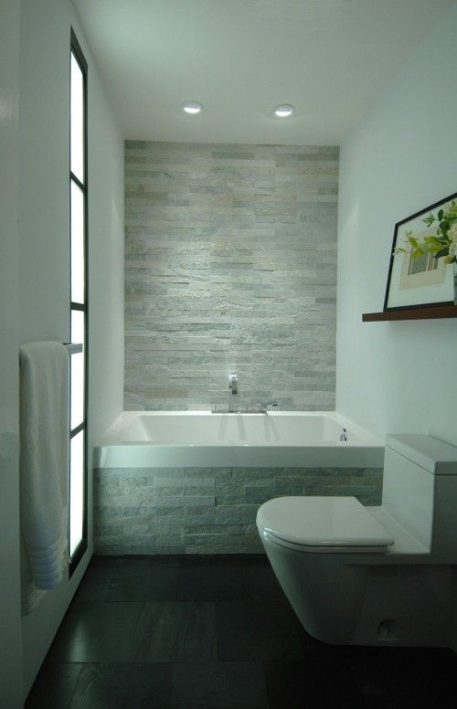 the mixture of smooth and textured tiles along with the soft hues of gray green create a serene spa like feeling in this bath modern bathroom - Small Bathroom Remodel Modern