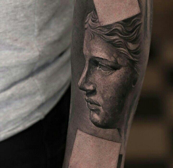 Realistic statue tattoo
