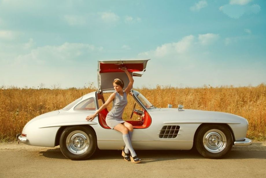 Absolutely a James Bond special, awesome gull wing door Mercedes, with a  very pretty 1960 s retro dressed woman, a little