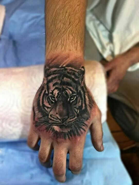 Tiger Hand Tattoo Hand Tattoos Tiger Hand Tattoo Tattoos For Guys