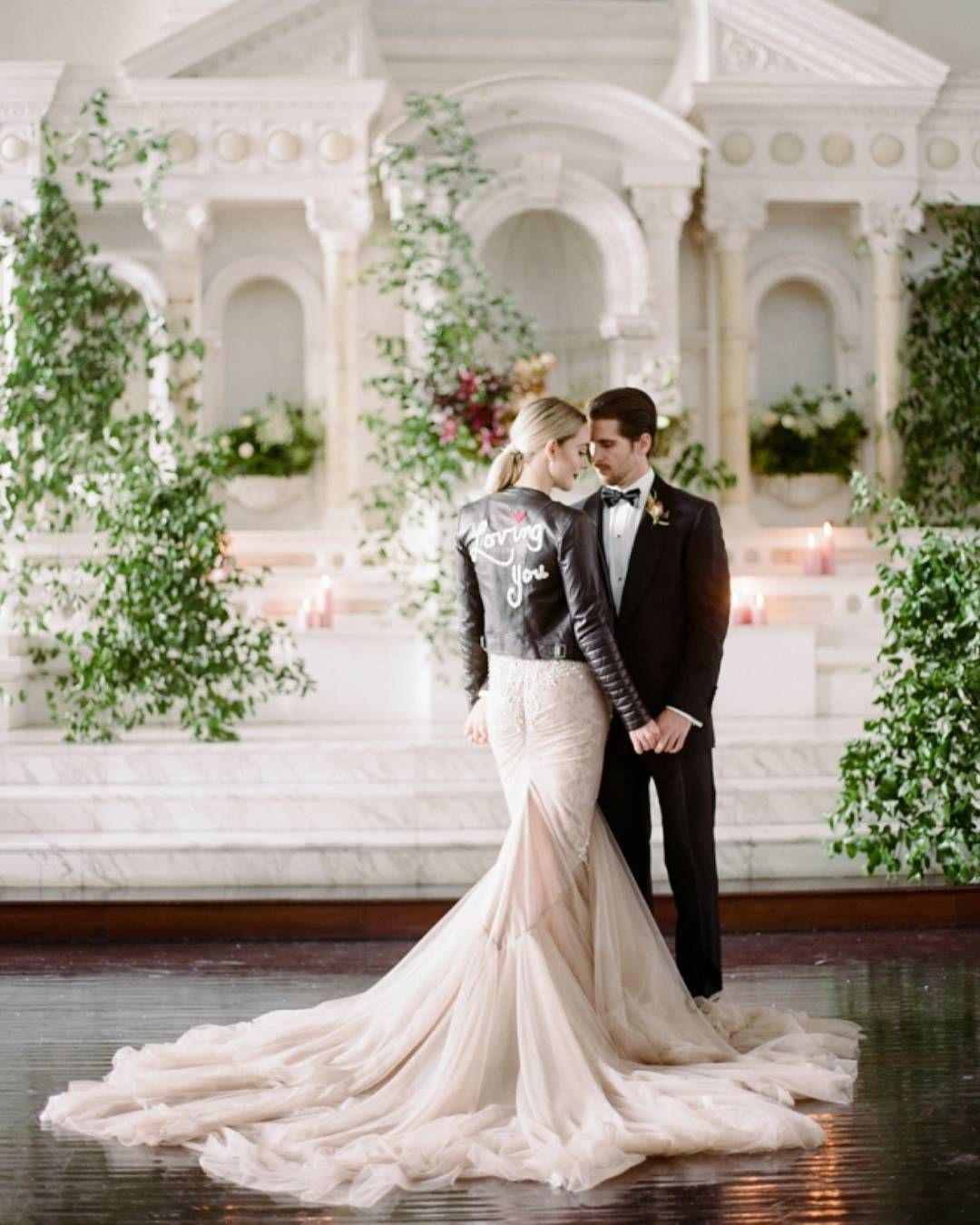 It's official. All the cool brides are wearing leather and lace — just ask @theskinnyconfidential! | Photography: @rebeccayale | Event Planning + Design: @roandcoevents | Floral Design: @emblemflowers | Fashion Styling: @anniecavallo | Wedding Dress: @inbaldrorofficial | Leather Jacket: @aliceandolivia | Bridal Boutique: @panachebeverlyhills | Hair + Makeup: @suziemoldavon | Furniture Rentals: @foundrentals | Tabletop Rentals: @casadeperrin | Venue: @vibianaevents