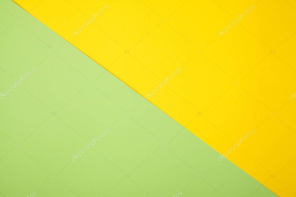 Green And Yellow Pastel Color Paper Geometric Flat Lay Background