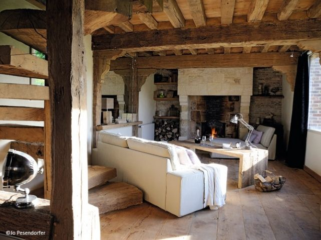 lovely living room in renovated old french country stable huge rustic wood beams stairs. Black Bedroom Furniture Sets. Home Design Ideas
