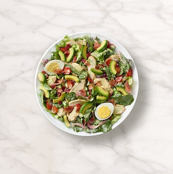 Chicken raised without antibiotics, arugula, romaine, kale and radicchio blend, grape tomatoes and pickled red onions tossed with freshly made Green Goddess dressing and topped with avocado, bacon, and cage-free hard-boiled egg. Available in whole and half. (Nutritional values below are based on whole serving. For detailed nutrition facts on all items based on serving size, please download our