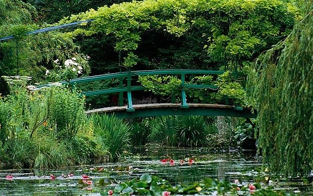 Monet's Gardens at Giverny, France  The world famous gardens of impressionist painter Claude Monet attracts art buffs and garden lovers in equal measure. The two main gardens surrounding the artist's house, a flower garden called The Clos Normand and The Water Garden are maintained as living works of art. The Water Garden with its Japanese bridge covered with wisterias and mass of waterlillies inspired one of the artist's greatest works.  Location: Situated in the village of Giverny