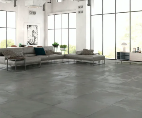 Minimal Industrial Living Room With Grey Tiles Living Room Flooring Industrial Livingroom Living Room Designs