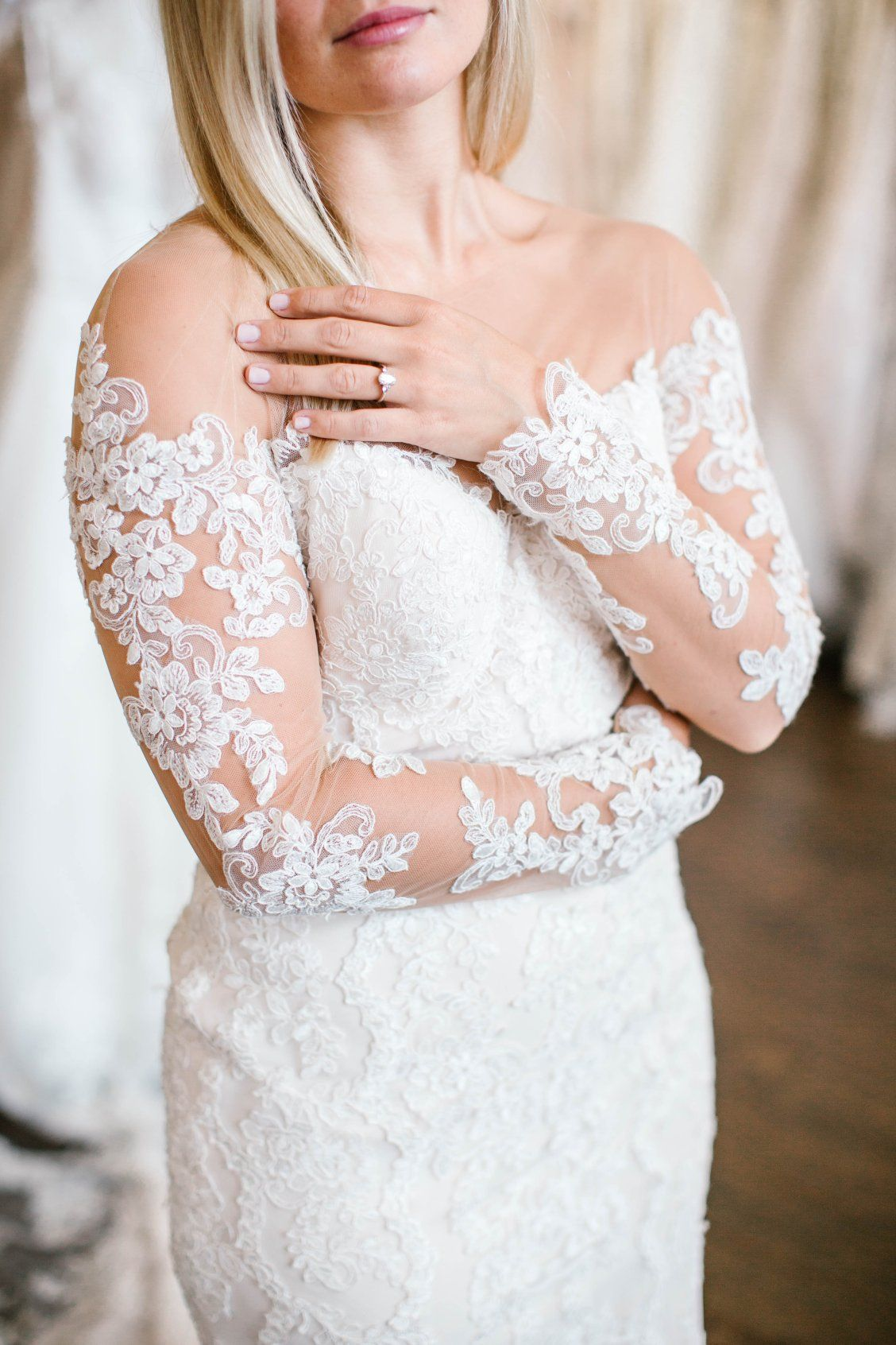 70407f87c7 This wedding gown from Stella York features romantic, long sleeves of  illusion lace that will ensure you are the center of elegance and attention.