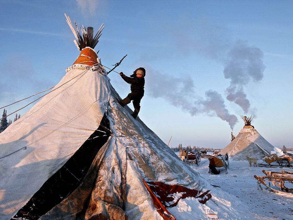 A Nenets child climbs his familyu0027s tent making for an unusual playground in Naryan-Mar part of the Nenets Autonomous Okrug district in Russia. & Nenets Camp Russia - National Geographic Travel Daily Photo ...