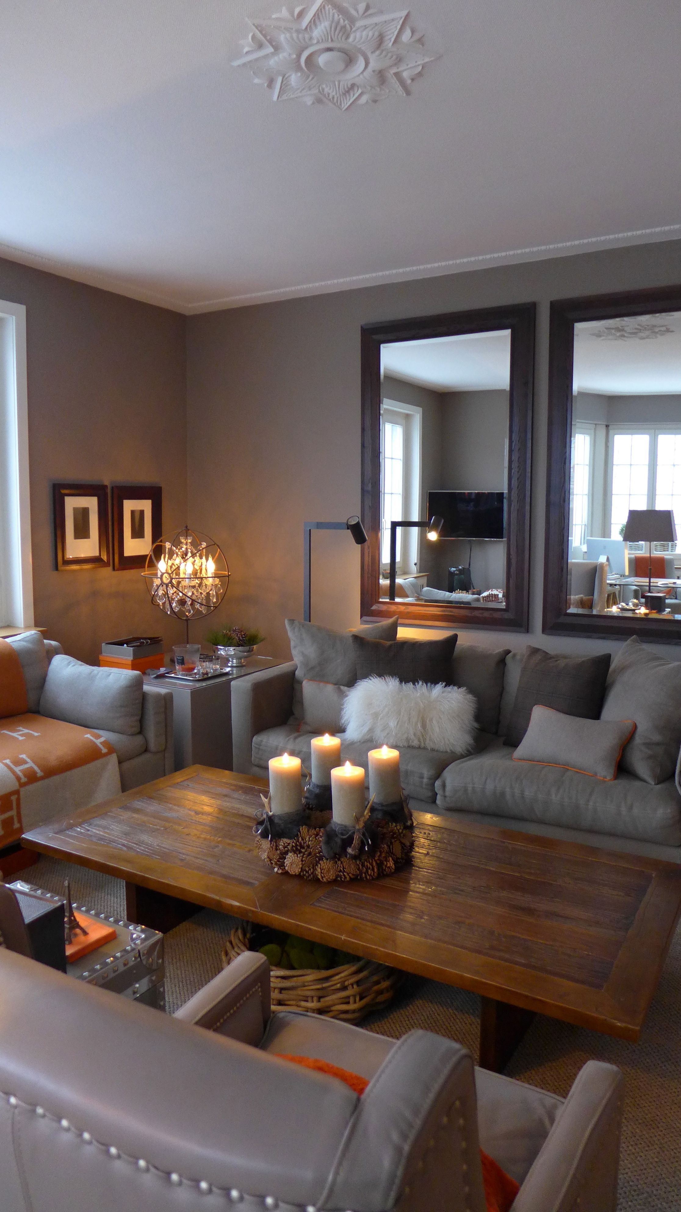 Warm and cozy living room in taupe with a touch of orange Warm cozy living room ideas