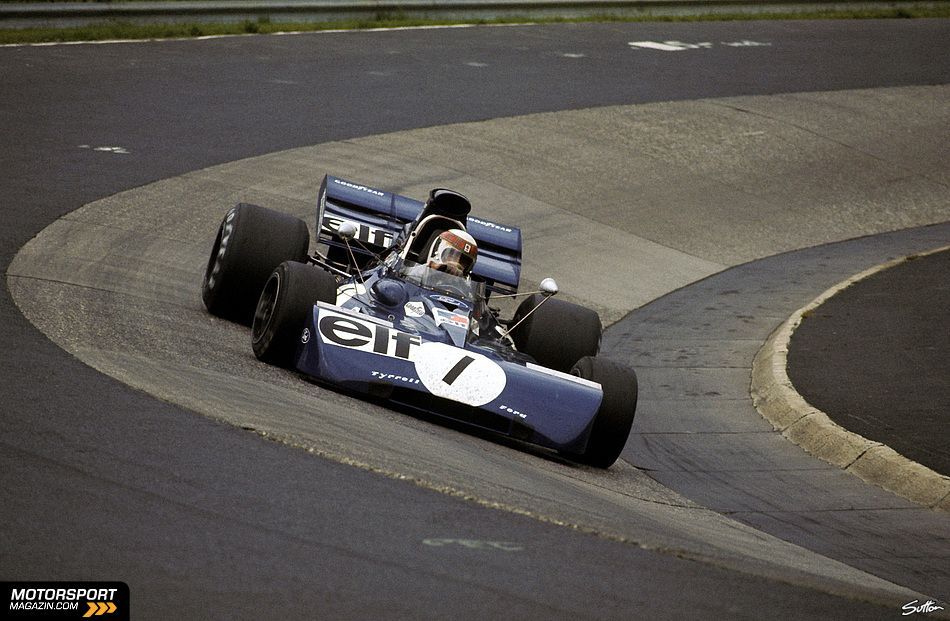 Jackie Stewart, Tyrrell 003, negotiating the Karussell, Nürburgring 1972. He was running third when a coming-together with Clay Regazzoni put him into the barrier.