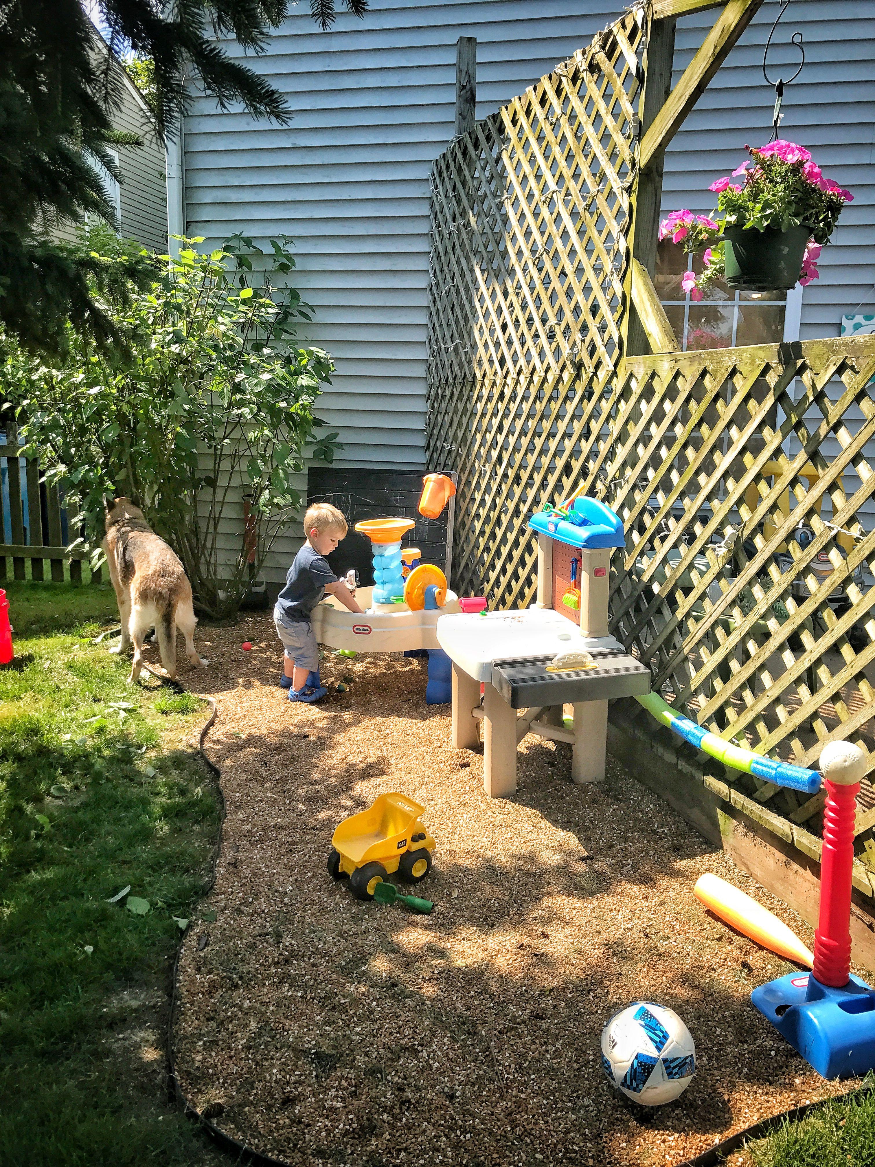 Backyard Kids Play Area Pea Gravel For Trucks And Chalk Board Paint Backyard For Kids