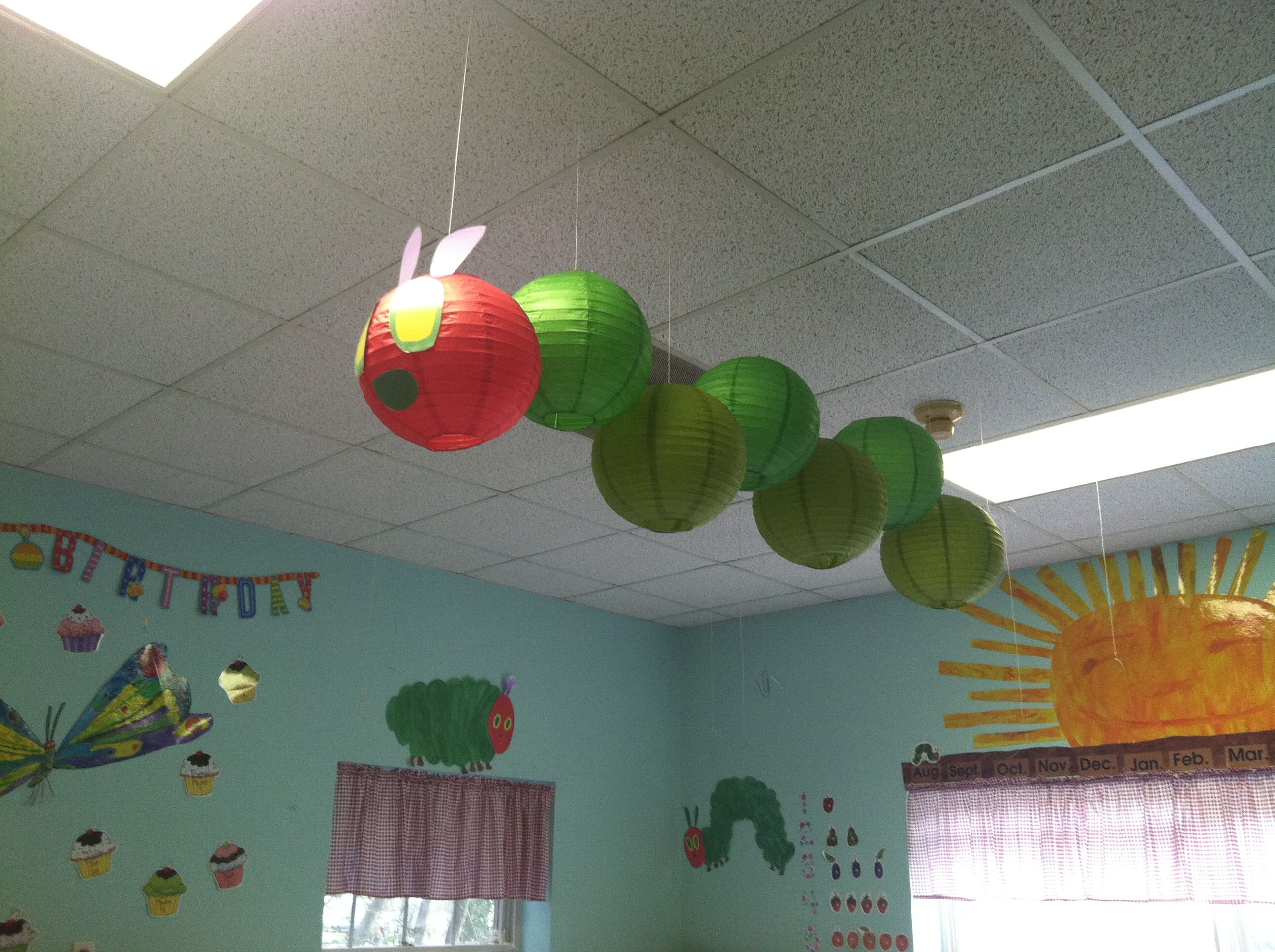Very hungry caterpillar lanterns hanging from ceiling in for Art and craft for school decoration