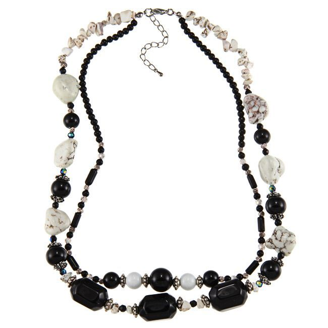 The classic colors and unusual design of this bold fashion necklace will turn heads on the street. The 20-inch long chain has a two-inch extender that lets you adjust its fit, and the black and white design will work with your entire wardrobe.