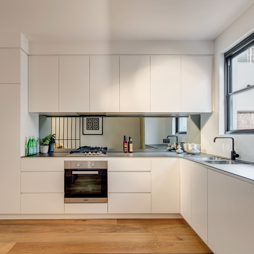 22 White Kitchens That Rock: 6mm Porcelain Benchtop, Mirror Splashback, Black Tapeware