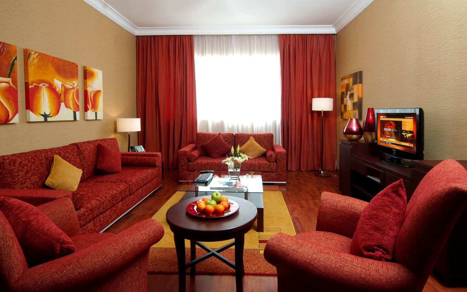 Great arabic living room with red sofa and yellow walls for Living room yellow walls