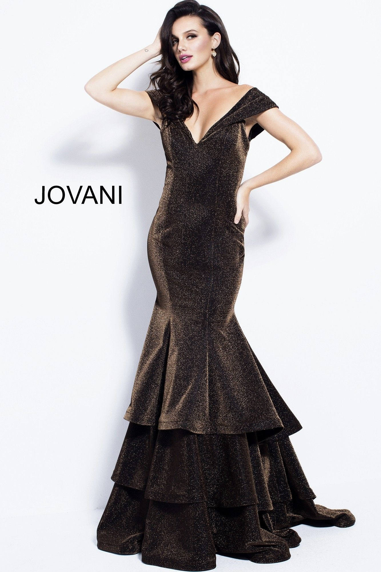2089cf156915f Get ready for your close-up in Jovani 56065. This sophisticated mermaid gown  has a deep V-neckline, with off-the-shoulder cap sleeves, and a V-shaped  back, ...