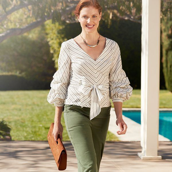 Sashed waist and dramatic sleeves–this is how you make an entrance. #whbm #WomenToWomen