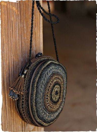 Artfully handcrocheted of glossy pima and shimmery Lurex threads, the evening bag is a petite jewel for evenings out.