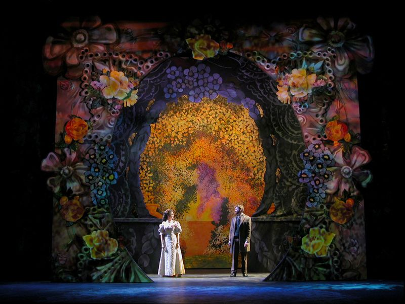 """This is the Secret Garden set. There are several main elements in this set. First, the color of the flowers and background. Second, the way the texture makes the flowers come to life, and the tile-like background looks """"shattered."""" Lastly, the lighting and how it reflects the shadows of the actors and actresses. Shape is also really used, but those three stood out to me the most."""