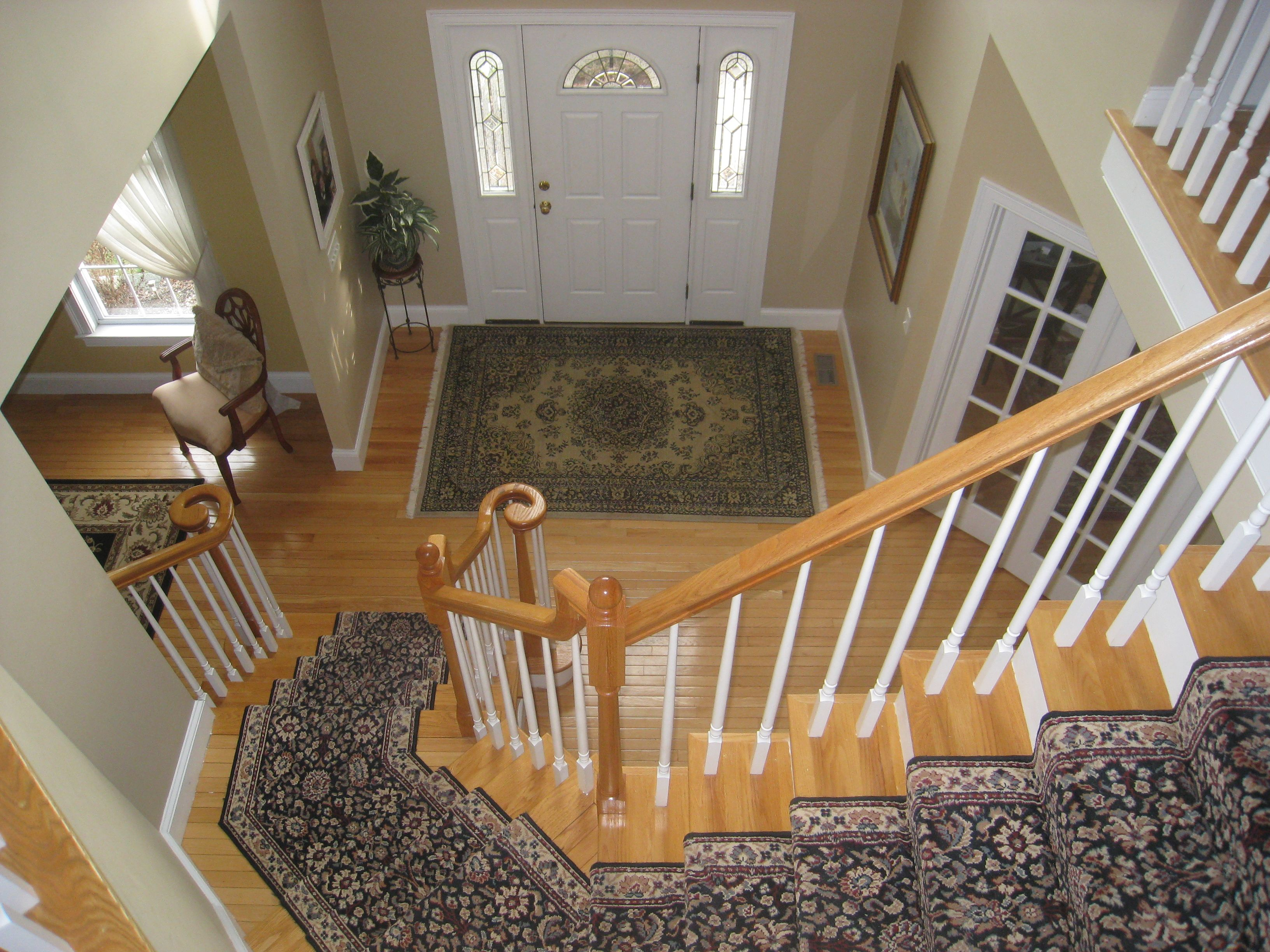 Beautiful two story foyer with double turned staircase.