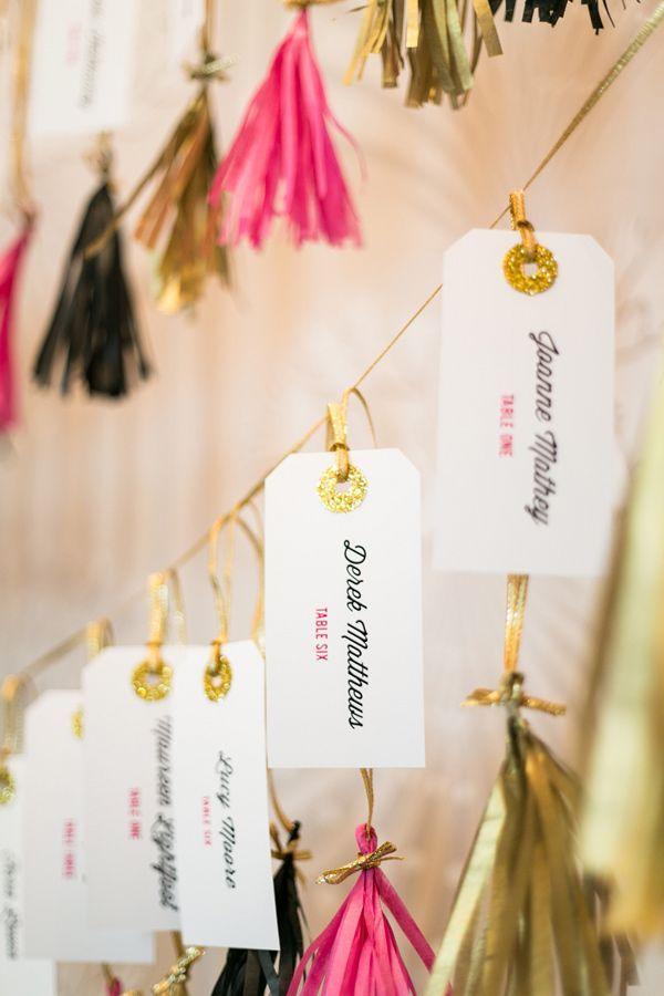 Gold, pink and black tassels with glittery gold escort cards #wedding #goldwedding #gold #escortcards #glitter
