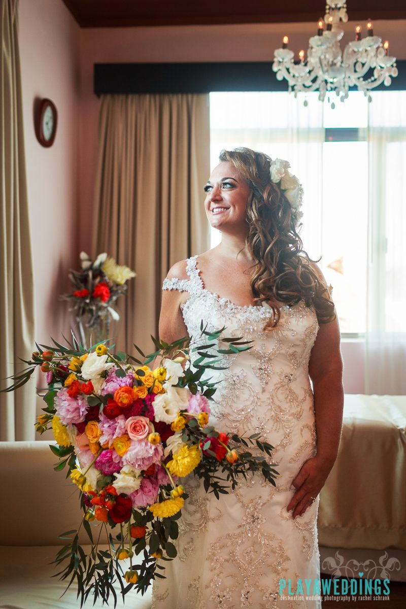 Bride in white lace wedding dress with most beautiful bridal bouquet