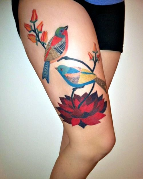 I hate the idea of a thigh tattoo, but this is gorgeous.