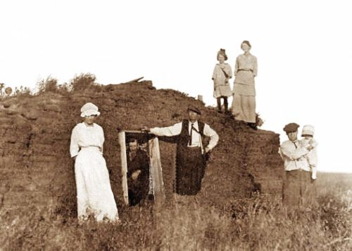 A Pioneer Family And Their Little Sod House On The Prairie Old