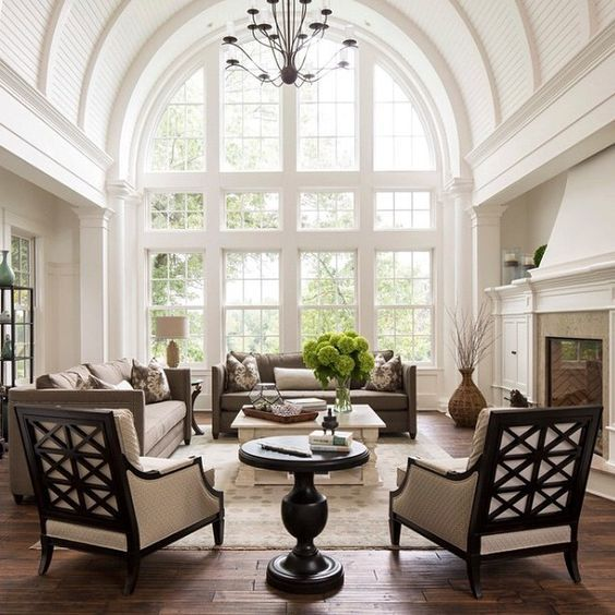 Nice lounge chairs.Classic french interior design. Large arched windows, soft colors and high ceilings.