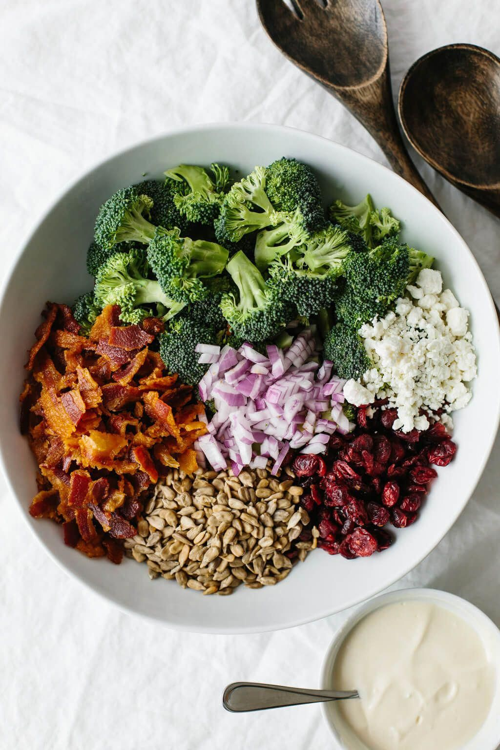 This delicious broccoli salad is a combination of broccoli, bacon, red onion, cranberries, sunflower seeds and goat cheese. It's an easy, healthy broccoli salad recipe.