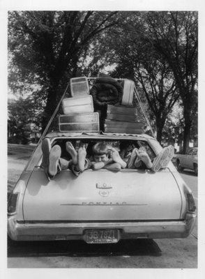 oh heavens, this REALLY reminds me of our family holidays - everyone piled in the station wagon and a TON of stuff on the roof rack (even though we were already towing a ton of stuff)