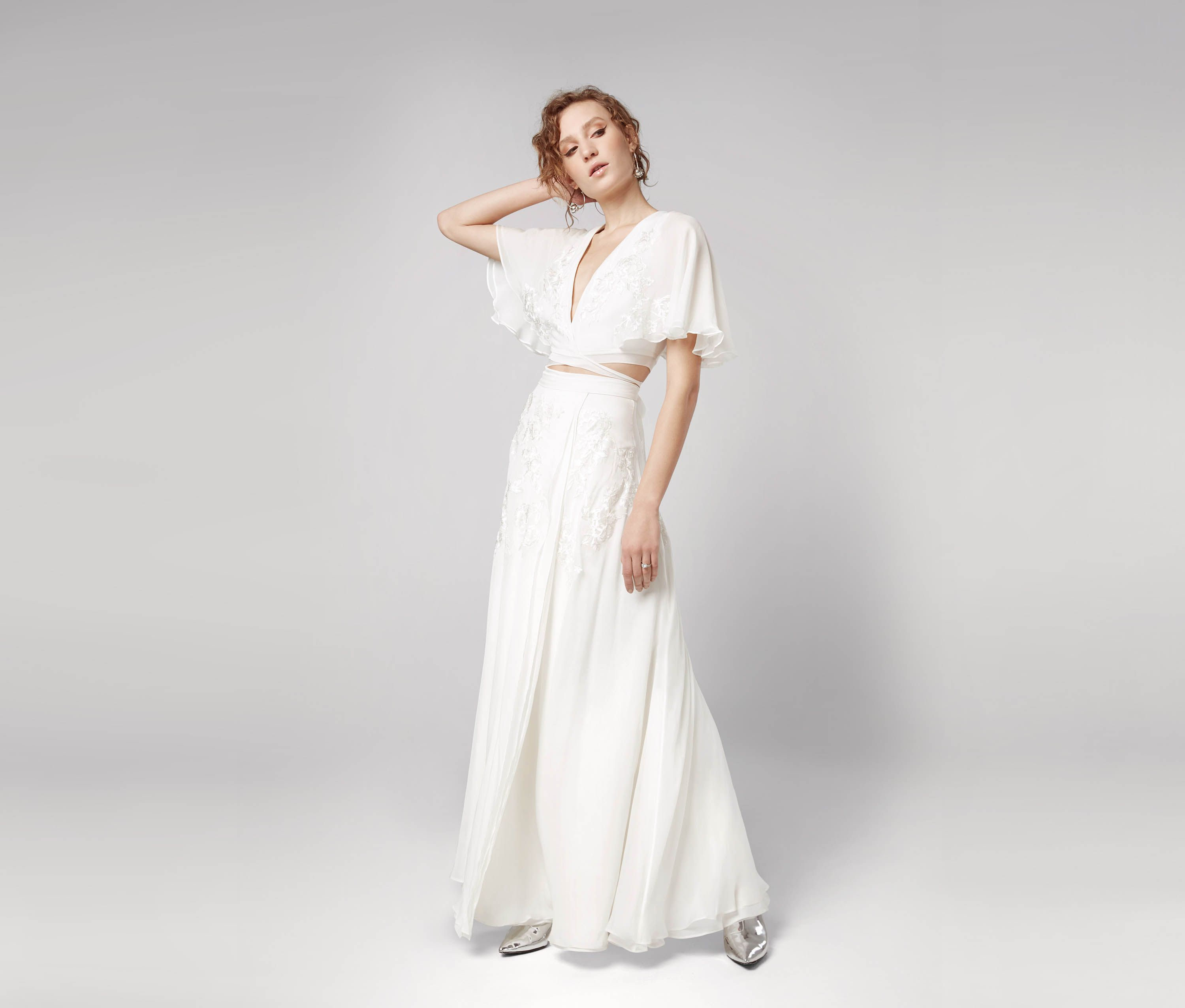 No Fuss No Stress Brides The Sylvie Is For You A Wrap Top With Wide Flowing Sleeves And Casual Wedding Dress Boho Style Wedding Dress Wedding Dress Outlet