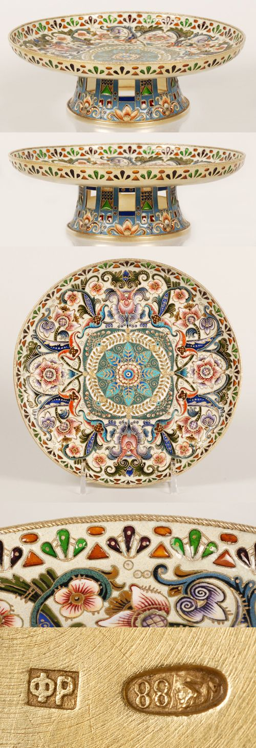 A Russian silver gilt, plique-q-jour and shaded cloisonne enamel tazza, Feodor Ruckert, Moscow, 1908-1917. HAving a flared foot with floral and geometric motifs, apertures filled with red and green plique-a-jour enamel, the bowl has exuberant flower heads on a duck-egg ground, the rim pierced with a geometric design and decorated with red, green and orange plique-a-jour enamel.