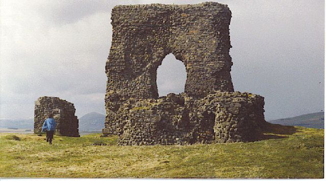 Dunnideer Castle, now ruined, was a tower house located near Insch, Aberdeenshire, Scotland. It was built c.1260 partially from the remains of an existing vitrified hill fort in the same location. It consisted of a single rectangular tower of 15m by 12.5m with walls 1.9m thick. Evidence suggests that a first-floor hall existed. Evidence Shows it Had several floors.