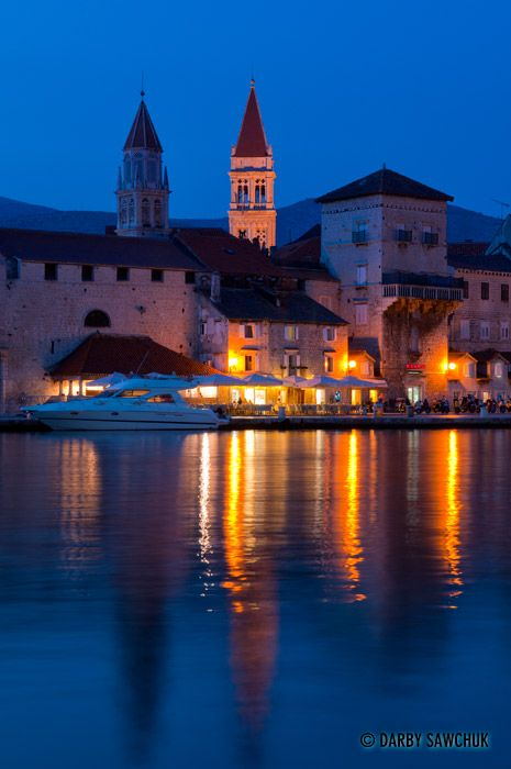 Trogir Cathedral's campanille peers above the buildings lining the boardwalk in Trogir, Croatia.