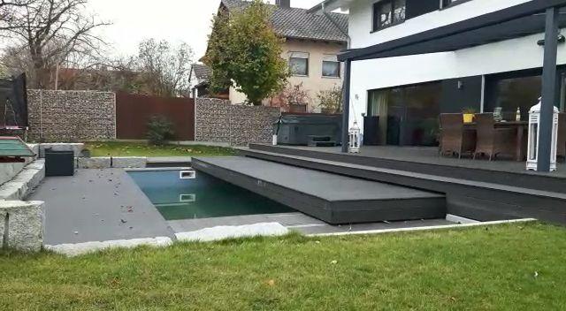 Automatische Swimming Pool Abdeckung die unterhalb der Terrasse verschwindet / sich absenkt