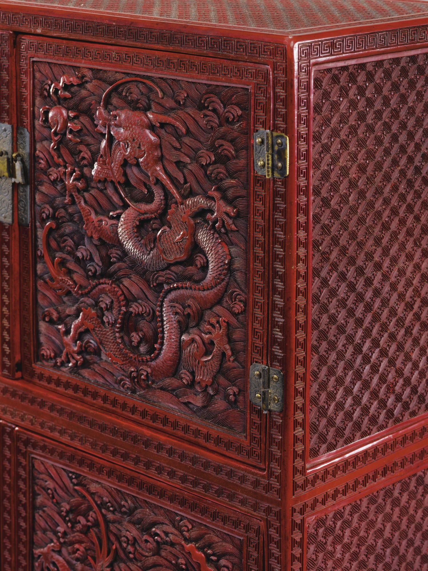 A SMALL CARVED CINNABAR LACQUER CABINET, QING DYNASTY, QIANLONG PERIOD