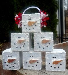 Snowman Cubes..wooden block and snow paint.  Gotta try some of these Sis!