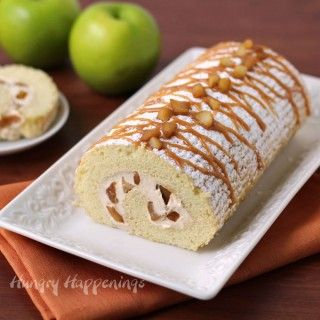 Caramel Glazed Cinnamon Apples blended with cream cheese fluff rolled up in a yellow cake and drizzle with caramel sauce.