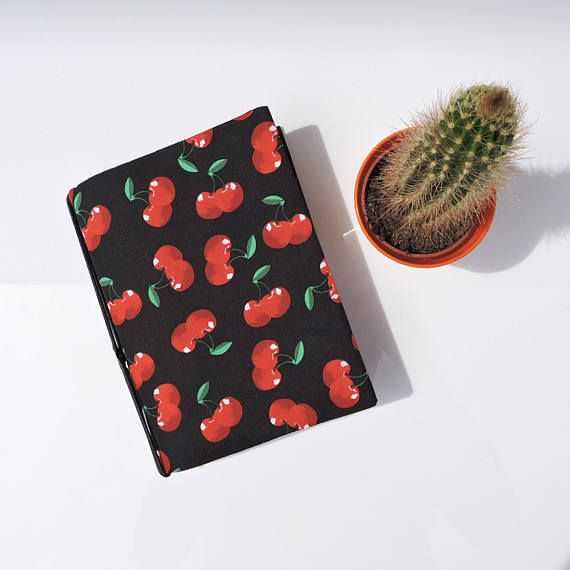 Succulent vintage cherry Hobonichi planner or book cover for anything up to an A6 book (152mm x 110mm or 6 x 4 3/8). Comes with two Hobonichi elastics, more can be easily added.  Each one is hand-crafted using leather like interlinings to enable me to produce a sturdy refillable journal in gorgeous fabric prints.  Great handbag size.  Made in gorgeous crisp 100% cotton. Has a firm back, is fully lined in red polka dot print, and with two elastics to hold your planner pages.  The two pock...