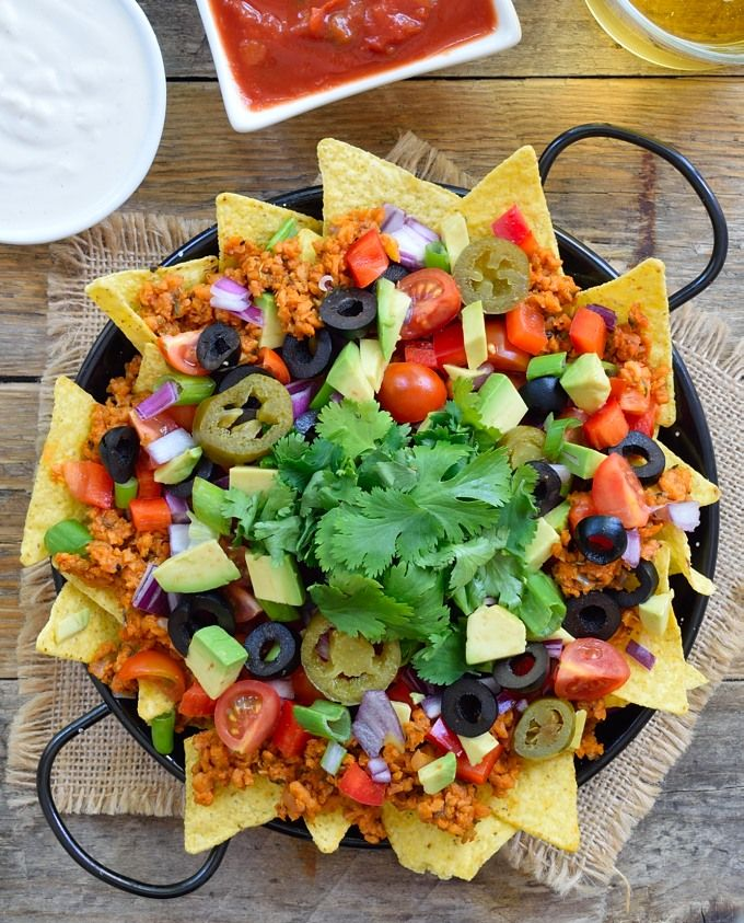 """Delicious, loaded veggie nachos with TVP taco """"meat"""". There's so much going on with these nachos that nobody will realize that they're totally plant-based and vegan."""