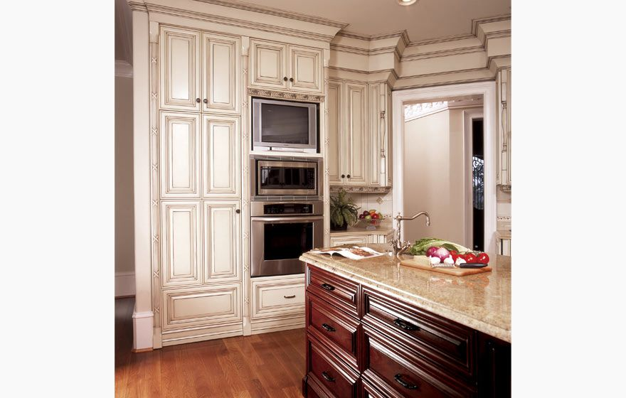 Wood Cabinets With Painted Island Honduras Mahogany Dazzles On The Island While The White Cabinetry Wood Cabinet Doors Wood Kitchen Wood Cabinets