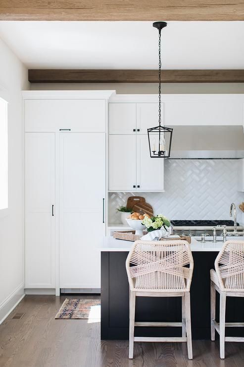 open concept kitchen remodel features a black center island with white perimeter cabinets b on kitchen remodel with island open concept id=91572
