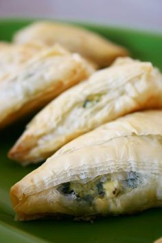 Spinach and Feta Turnovers  1/2 onion, chopped  1 T. butter  2 small cloves of garlic, chopped  1 package frozen chopped spinach, drained and squeezed dry  4 oz. crumbled feta cheese  1 egg, slightly beaten  dash of fresh-grated nutmeg  freshly ground black pepper  pinch of salt  20 sheets store-bought phyllo dough  1/2 C. butter, melted