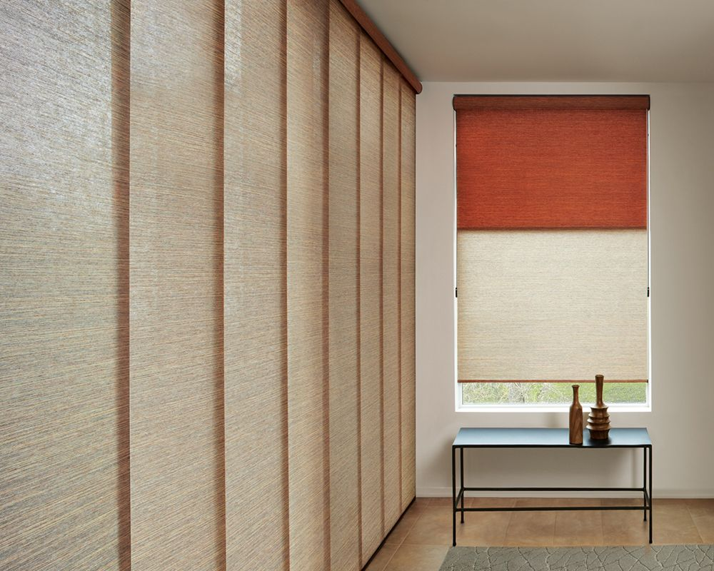 The Perfect Coordination Of Hunter Douglas Roller Shades And Skyline Gliding Window Panels Offers Effortless S Living Room Shades Window Styles Hunter Douglas