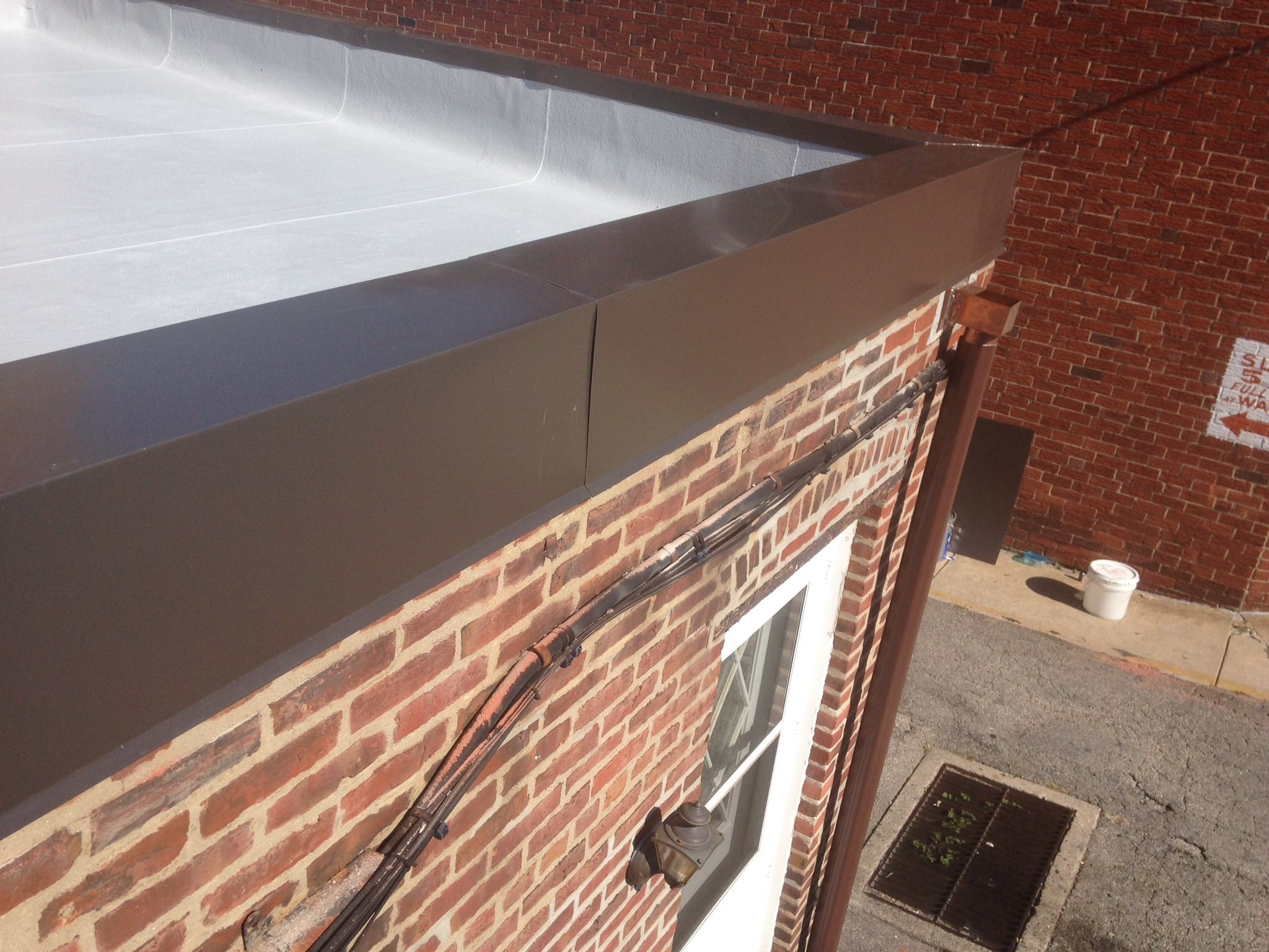 Modified Bitumen Flat Roof W Gray Silicone Coating 032 Bronze Aluminum Coping And Soldered Copper Scupper Bo Flat Roof Repair Roofing Contractors Homeowner
