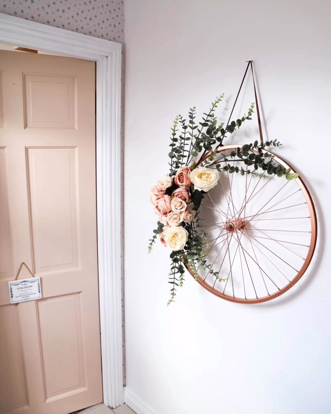 Transform an old bike frame into a #wreath by using some faux flowers and spray paint! Recycle and make the best of waste #homedecor #homedecoration #homedecorating #homedecore #homedecorations #homedecorideas #homedecorlovers #homedecorblogger #homedecors #homedecorator #homedecorinspo #homedecorationideas #homedecorate #homedecorinspiration #homedecormurah #homedecorlover