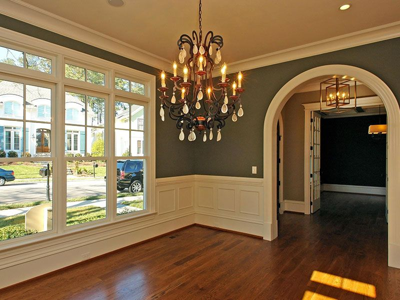 Round Archway and wainscoting in entry foyer and dining ...
