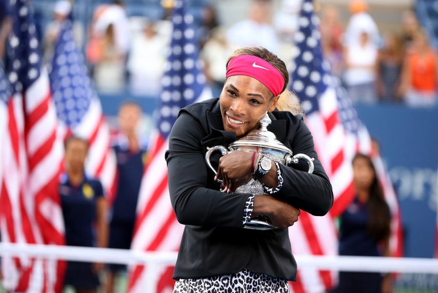 #tennis #champion #Serena #Williams of #United #States,1981, wins 18th #Grand #Slam in 2014.  She is embracing the #US #Open Trophy.  Posted on icon360.blogspot.com